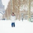 Girl walking in Paris on a snow day — Stock Photo #36945215