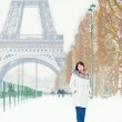 Girl walking in Paris on a snow day — Stock Photo #36945437