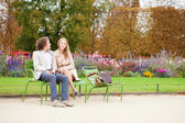 Happy couple in the Tuileries garden of Paris — Stock Photo