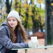 Stock Photo: Girl drinking coffee in an outdoor cafe