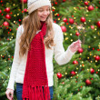 Girl with a sparkler near Christmas tree — Stock Photo