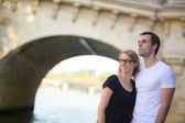 Young couple in Paris on the embankment — Stock Photo