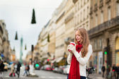 Girl with take away coffee on a Parisian street — Stock Photo