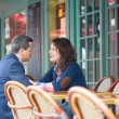 Couple in an outdoor Parisian restaurant — Stock Photo #38064253