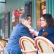 Couple in an outdoor Parisian restaurant — Stock Photo #38064283