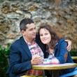 Couple hugging in an outdoor cafe — Stock Photo #38064433