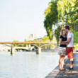 Couple in love near the Seine — Stock Photo
