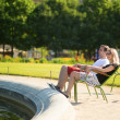 Couple relaxing in Tuileries garden of Paris — Stock Photo #38065779