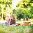Stock Photo: Girl on picnic in park