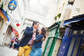 Couple dancing on a street of Montmartre — Stockfoto
