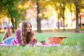 Girl on a picnic in park — Stock Photo
