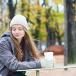 Stock Photo: Girl drinking coffee in an outdoor Parisian cafe