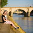 Young couple in Paris near the Seine — Stock Photo #39070771