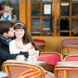 Dating couple kissing in a cafe — Stock Photo