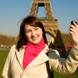 Happy beautiful woman in Paris using phone camera — Stock Photo
