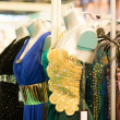 Stock Photo: Evening dresses in store