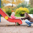 Stock Photo: Mother and daughter on playground
