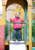 Adorable little girl having fun on the playground — Stock Photo