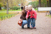 Mother and daughter enjoying a fall day — Stock Photo