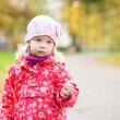 Outdoor autumn portrait of thoughtful little girl — Stock Photo