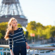 Girl in Paris on a sunny spring or fall day — Stock Photo