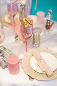 Table set for event with a compliment for guests — Stock Photo