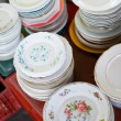 Antique plates on flea market — Stock Photo