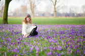 Woman on the crocus field on a spring day — Foto Stock