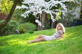 Beautiful young woman relaxing in park — Stock Photo