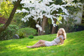 Beautiful young woman relaxing in park — Stock Photo