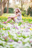 Beautiful young girl in forest on a spring day — Stock Photo