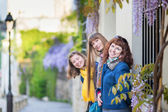 Three girls on a street of Montmartre — Stock Photo