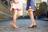 Women talking in a street — ストック写真