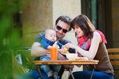 Happy family of three having breakfast — Stock Photo