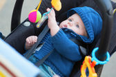 Little baby boy in a stroller — Stock Photo