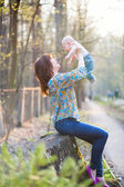 Young mother with her son in a spring forest — Stock Photo