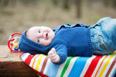 Adorable 4 month baby boy lying on his back — Stock Photo