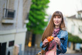 Girl with croissant on a street of Montmartre — Stock Photo