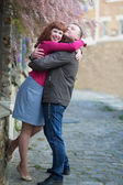 Happy couple on a Parisian street — Stock Photo