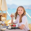 Beautiful young woman in a beach restaurant — Stock Photo #46568647