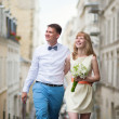 Bride and groom walking down the street in Paris — Stock Photo #47853053