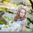 Young woman in blooming cherry garden — Stock Photo #47854595