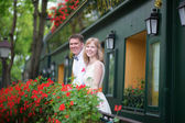 Happy young newly-wed couple on a balcony — Stock Photo
