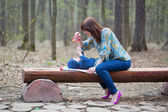 Mother playing with her baby in forest — Stock Photo