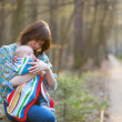 Young mother with her little baby in forest — Stock Photo #48064659