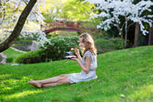 Woman eating sushi in   park — Stock Photo