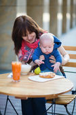 Mother with baby in  cafe — Stock Photo