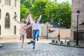 Just married couple jumping — Stock Photo