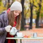 Girl in outdoor Parisian cafe — Stock Photo #48513807