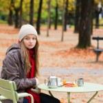 Girl in outdoor Parisian cafe — Stock Photo #48514131